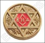 Spilla stella e simboli